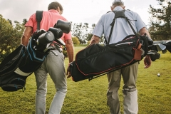 Golfers-Carrying-Clubs