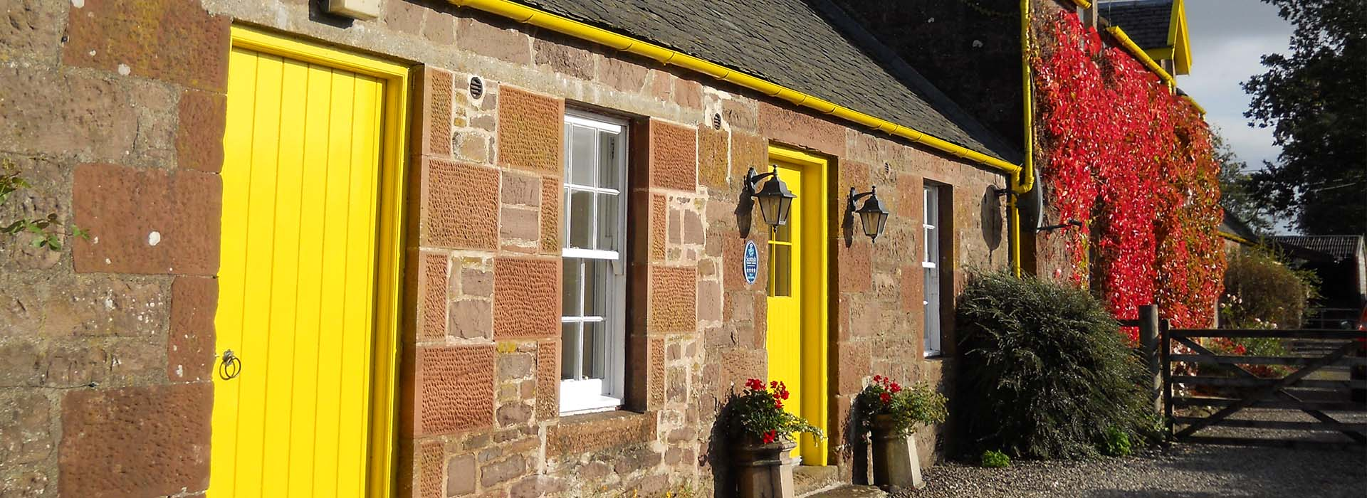 The colourful exterior of Ballat Smithy Cottage near Loch Lomond