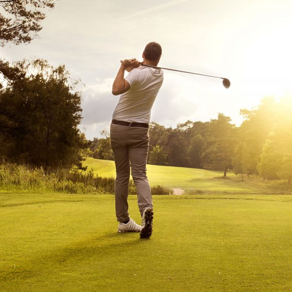 A male golfer taking a swing
