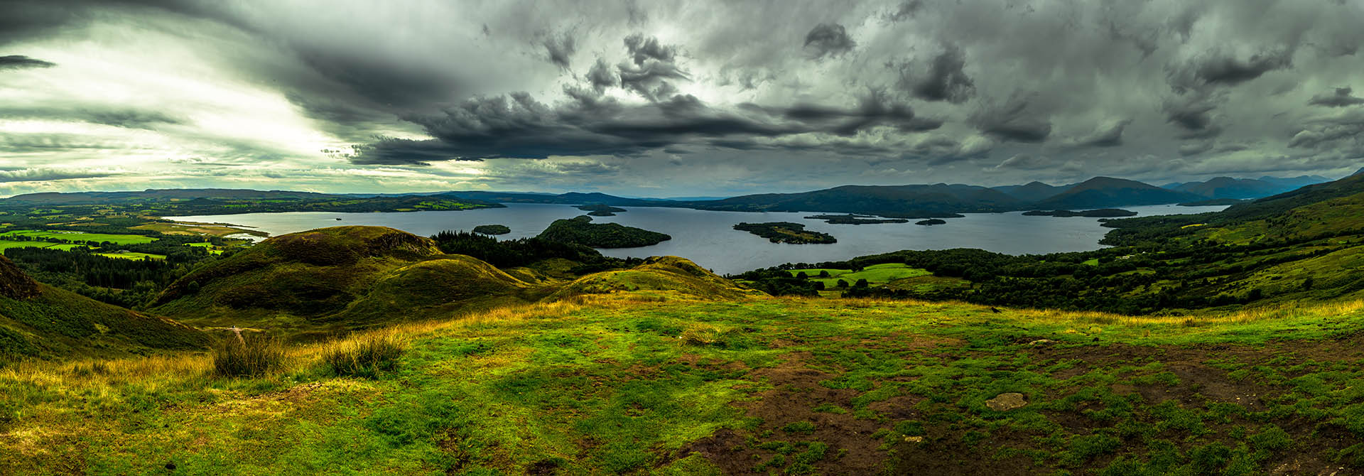 A panorama view of Loch Lomond on a moody day