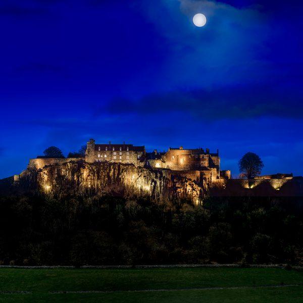 Stirling Castle lit up at night time