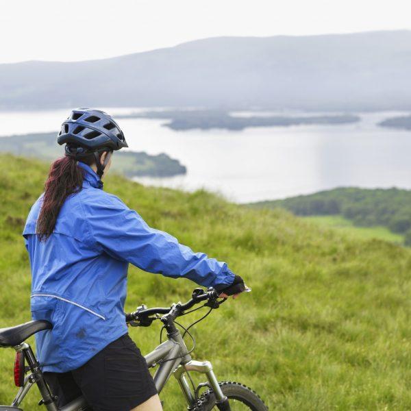 Lady mountain biking above loch lomond