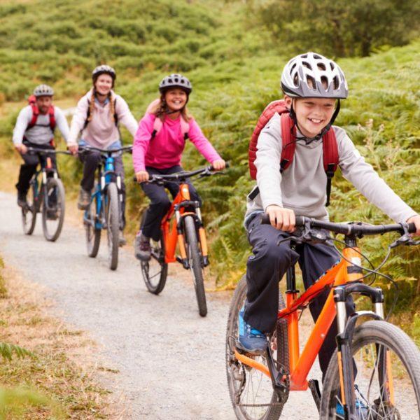 Scotland family cycling holidays, a family cycling through braken